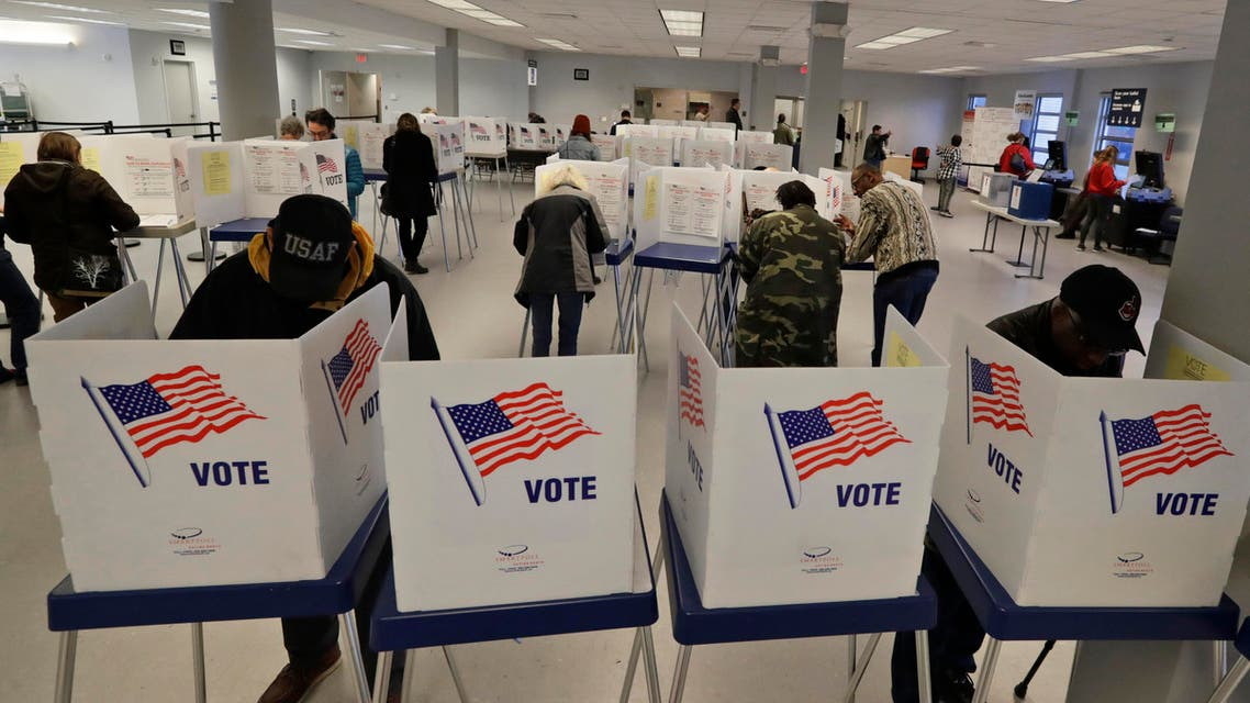 People participate in early voting, Friday, March 13, 2020, in Cleveland. (AP)