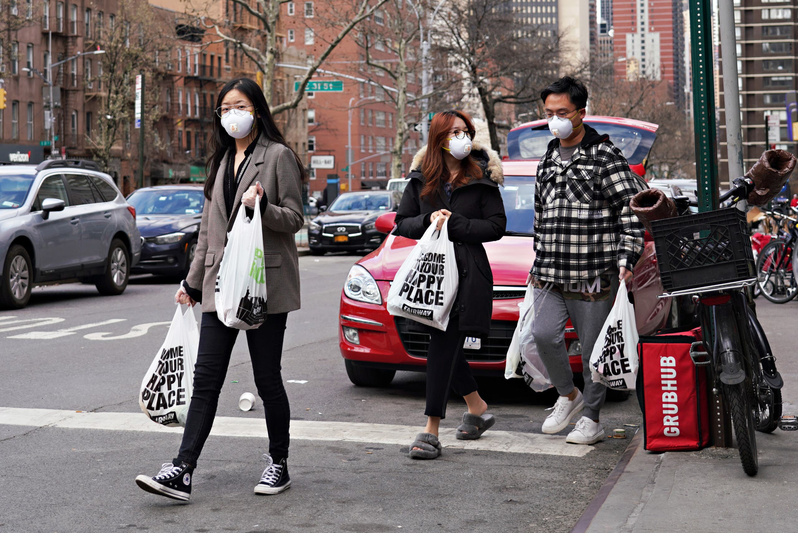 Shoppers wear protective face masks as they leave Fairway Market as coronavirus continues to spread across the United States on March 16, 2020 in New York City.  (AFP)