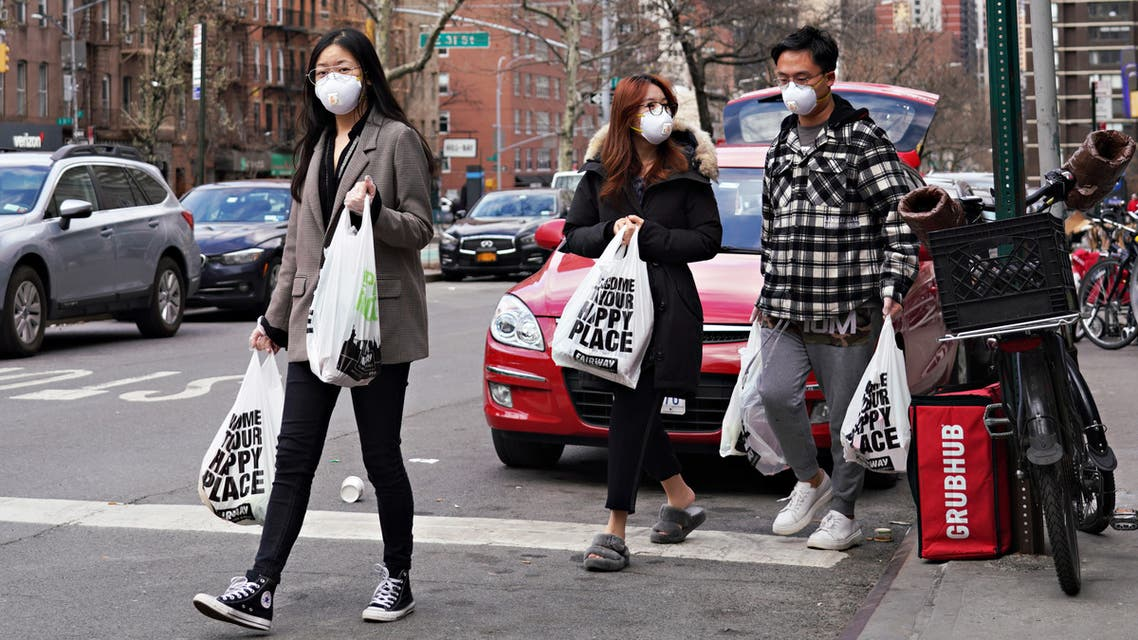 NEW YORK, NY - MARCH 16: Shoppers wear protective face masks as they leave Fairway Market as coronavirus continues to spread across the United States on March 16, 2020 in New York City. The World Health Organization declared coronavirus (COVID-19) a global pandemic on March 11th. Cindy Ord/Getty Images/AFP