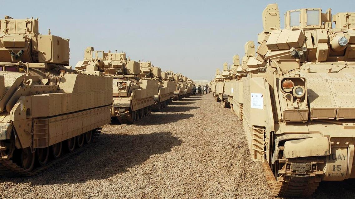 Ammunition carriers stand ready for final inspection at the Four Corners staging area at Camp Taji in Baghdad, October 19, 2009, before they are transported to Kuwait for eventual shipment back to the US. (Reuters)