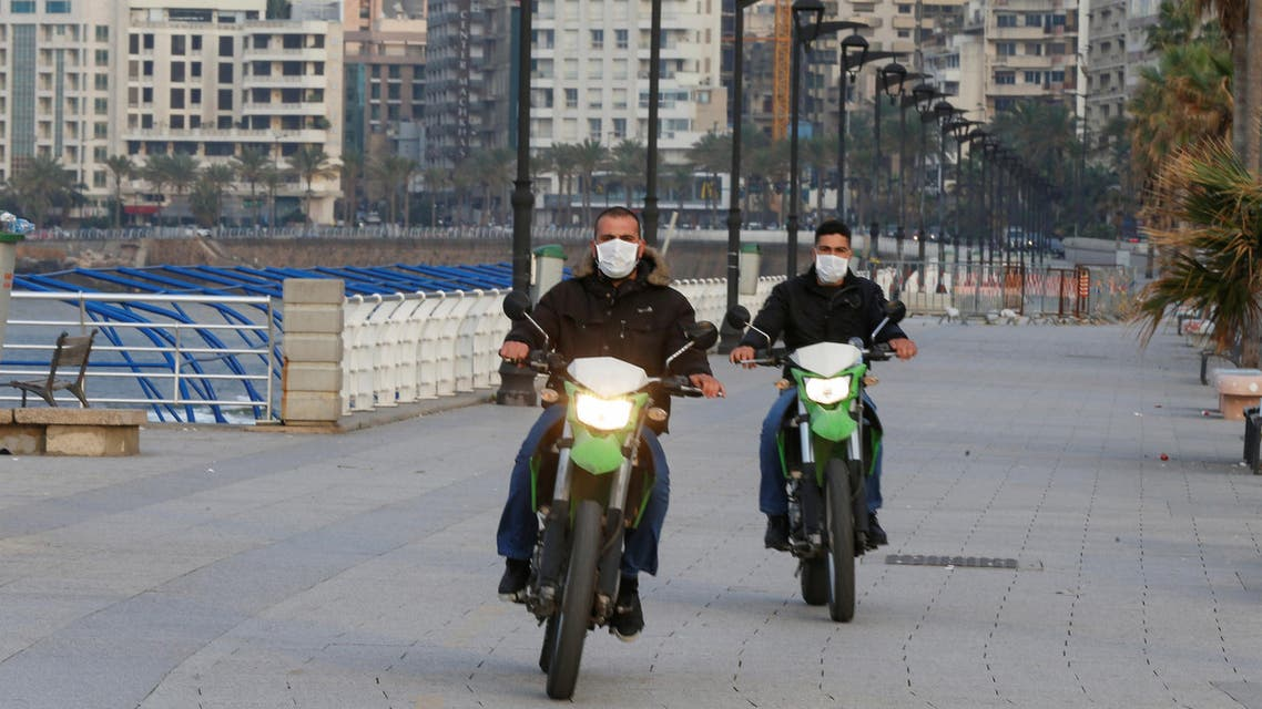 Police members wear face masks as they ride on motorbikes at Beirut's seaside Corniche as Lebanon declared a medical state of emergency on Sunday as part of the preventive measures against the spread of the coronavirus, in Beirut, Lebanon March 15, 2020. (Reuters)