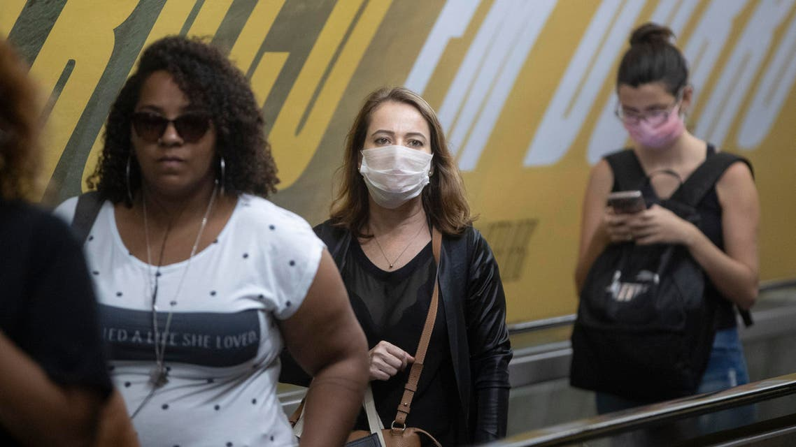 Commuters wear face masks as a precaution against the spread of the new coronavirus in a subway station in Sao Paulo, Brazil, Monday, March 16, 2020. (AP)
