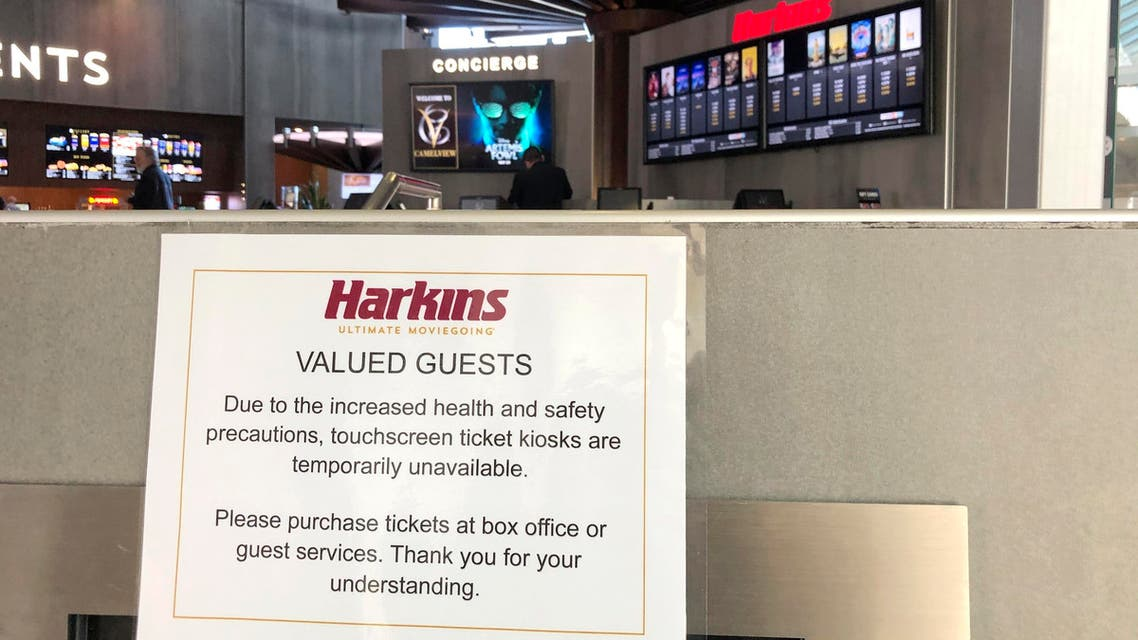A sign directs theater-goers to the box office after they closed their touchscreen ticket kiosks at a local mall, due to concerns of the coronavirus, on March 14, 2020, in Scottsdale, Arizona (AP)