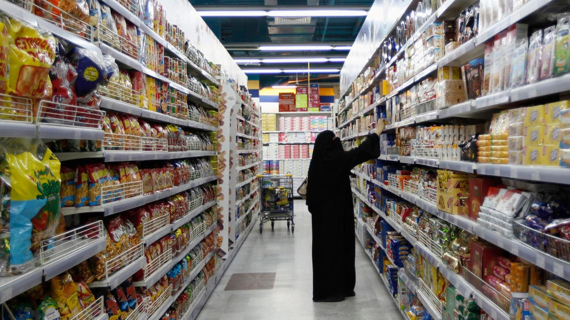 A woman looks at products as she buys food supplies at a supermarket in Dubai. (File photo: Reuters)