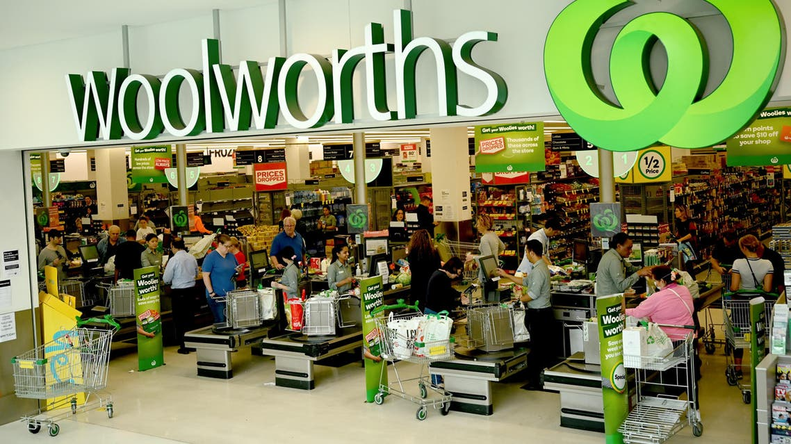 People shop at a Woolworths supermarket in Sydney on March 17, 2020. (AFP)