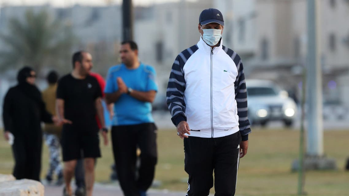 A man wears a protective face mask, as he walks, after Saudi Arabia imposed a temporary lockdown on the province of Qatif, following the spread of coronavirus, in Qatif. (Reuters)