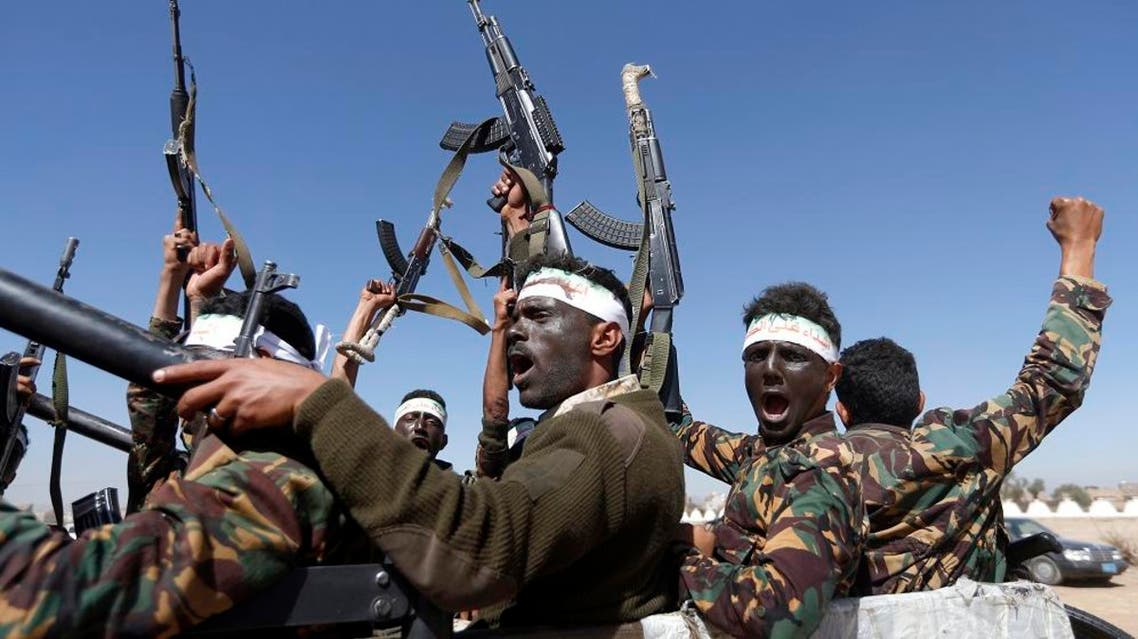 Newly recruited Houthi fighters chant slogans as they ride a military vehicle. (File photo: AFP)