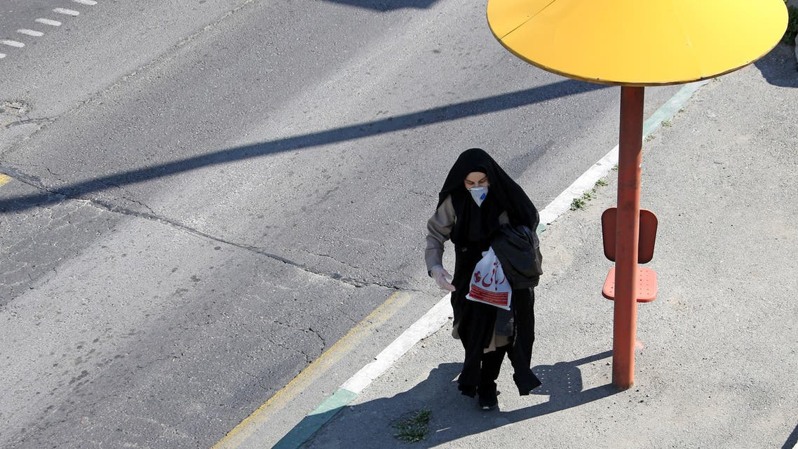 Iranian pedestrians cross a street while wearing protective masks in Tehran on March 10, 2020 amid the spread of coronavirus in the country. Iran today reported 54 new deaths from the novel coronavirus in the past 24 hours, the highest single-day toll since the start of the country's outbreak.