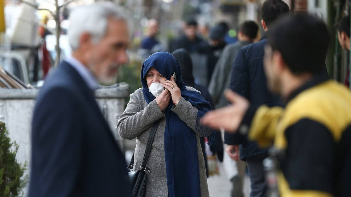 An Iranian woman wears a protective face mask, following the coronavirus outbreak, as she talks on the phone, in Tehran, Iran March 5, 2020. WANA (West Asia News Agency)/Nazanin Tabatabaee via REUTERS ATTENTION EDITORS - THIS IMAGE HAS BEEN SUPPLIED BY A THIRD PARTY.