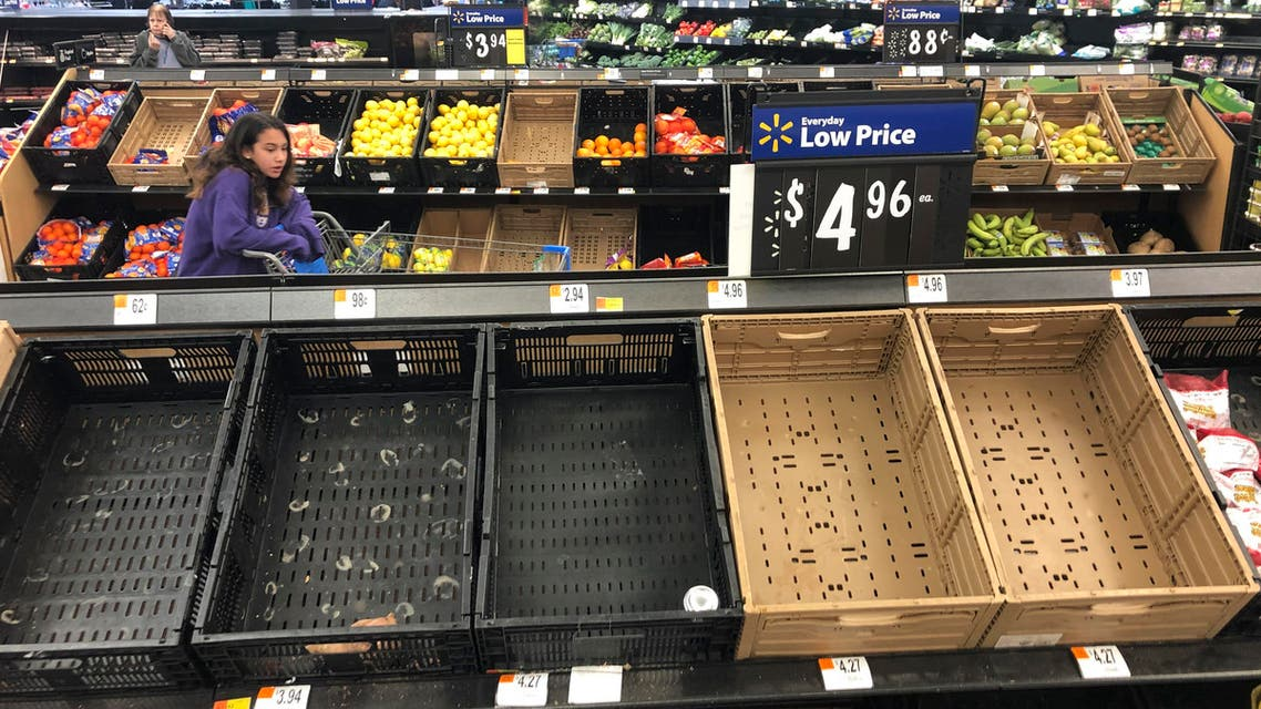 Display baskets are nearly empty in the produce section of a Walmart in Warrington, Pennsylvania, on March 17, 2020. Concerns over the new coronavirus have led to consumer panic buying of grocery staples in stores across the country. (AP)