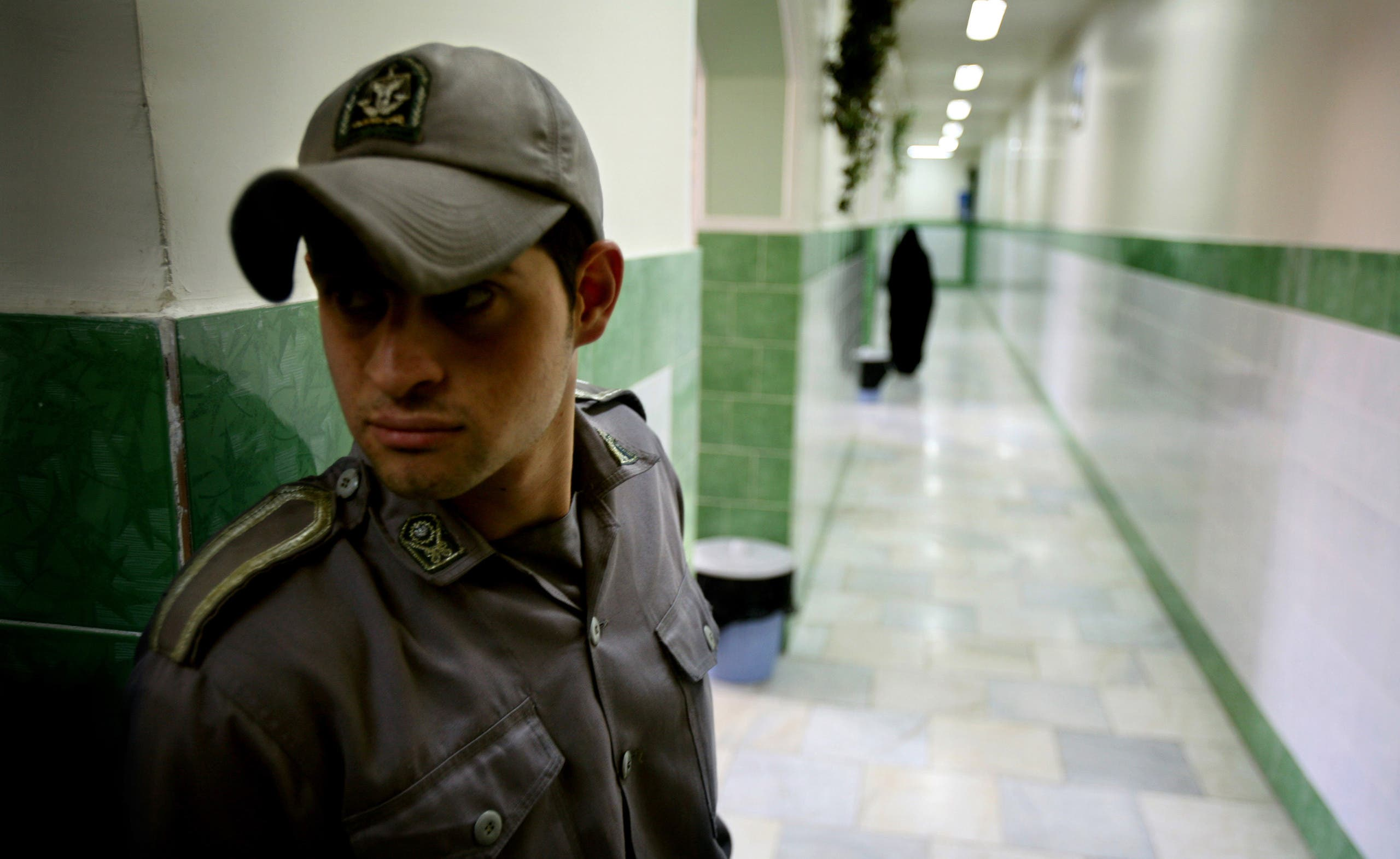 A prison guard stands along a corridor in Tehran's Evin prison June 13, 2006. (AP)