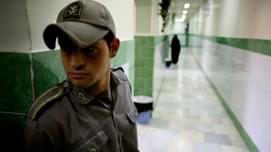 A prison guard stands along a corridor in Tehran's Evin prison June 13, 2006. (AP)