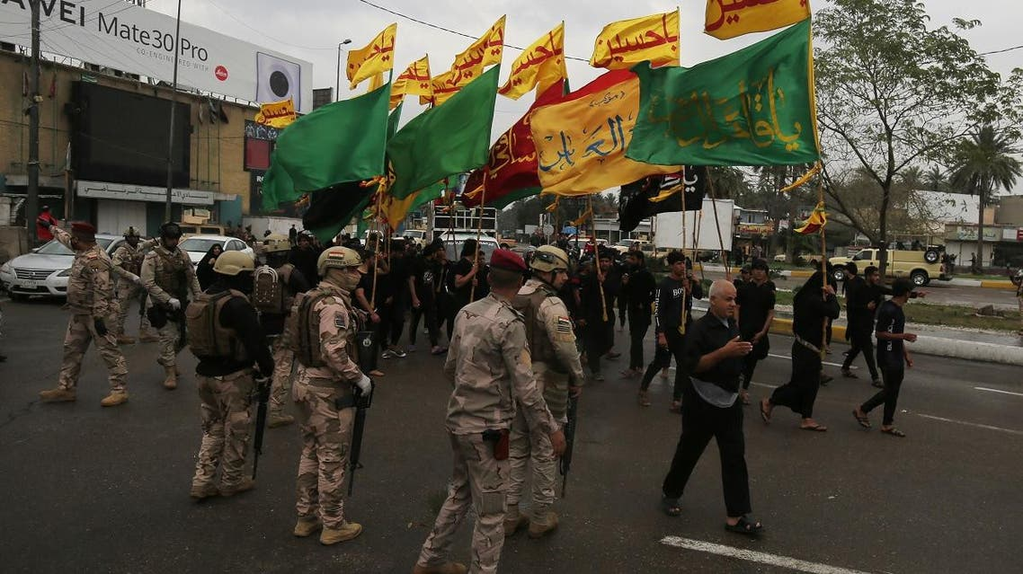 Iraqi shia pilgrims make their way to the shrine of Imam Moussa al-Kadhim to commemorate his death, although many shrines are closed due to the coronavirus outbreak, on March 18, 2020. (AFP)
