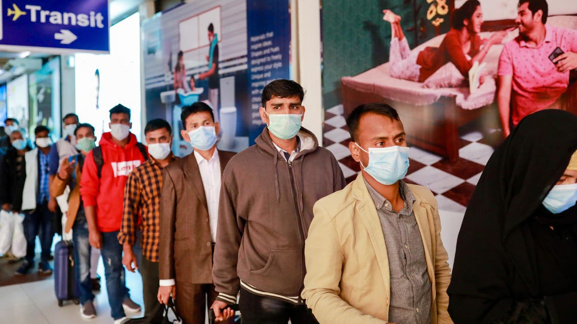 Passengers wear masks at the Hazrat Shahjalal International Airport as a preventive measure against coronavirus in Dhaka, Bangladesh. (Reuters)