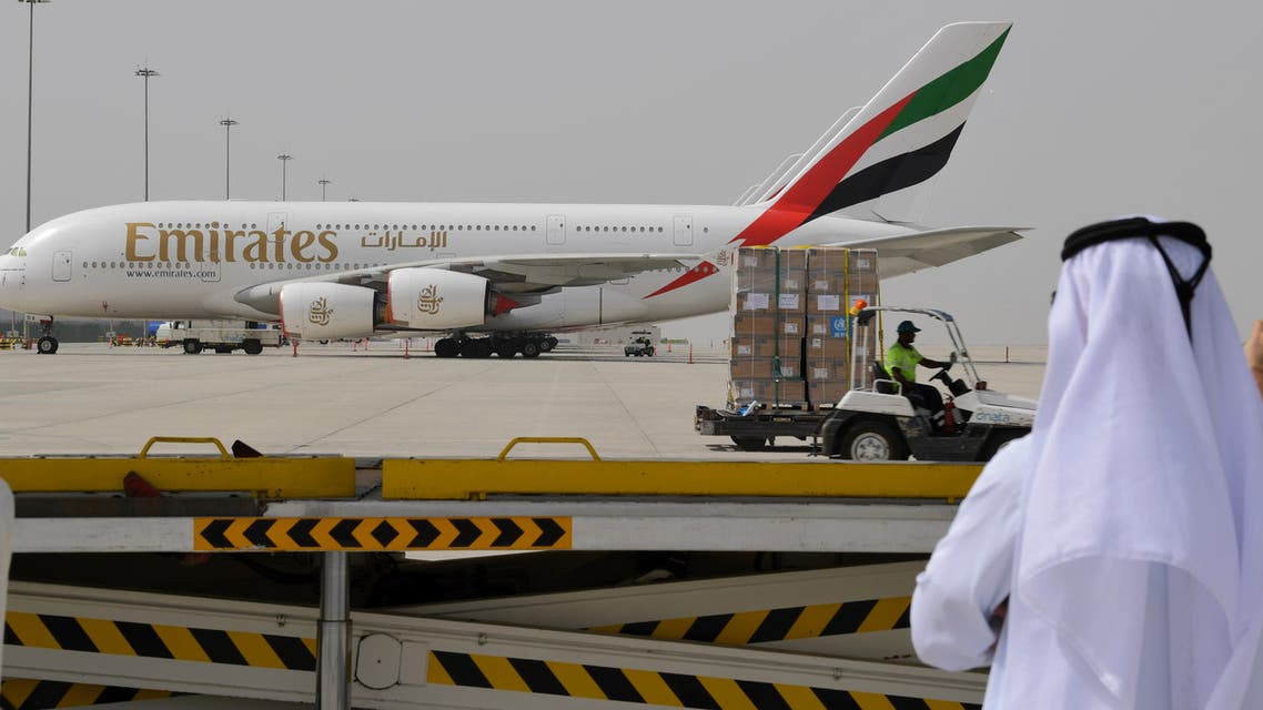 Dubai airport man watches Emirates plane - AFP