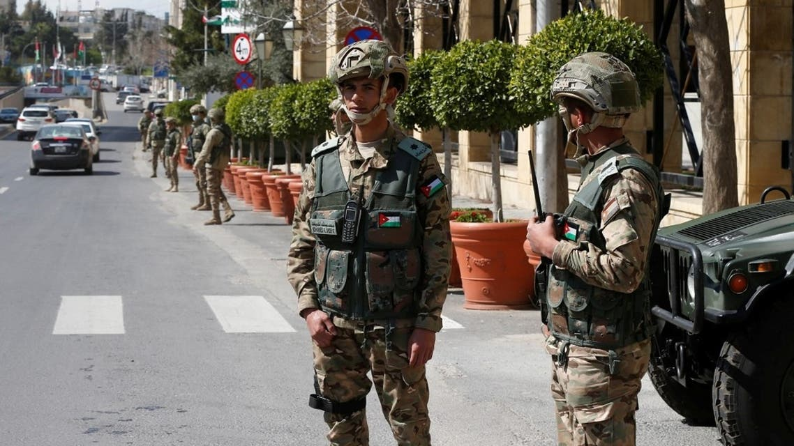 Jordanian army members stand guard outside a hotel that was transformed into a quarantine station amid concerns over the coronavirus (COVID-19) in Amman, Jordan, March 17, 2020. (Reuters)