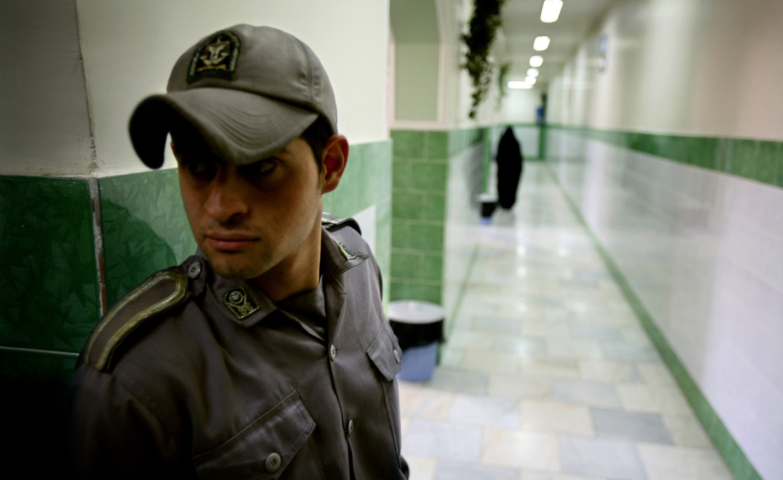 A prison guard stands along a corridor in Tehran's Evin prison on June 13, 2006. (AP)