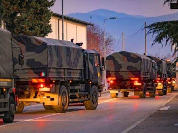 شاهد الجيش الإيطالي ينقل بالشاحنات جثث الضحايا لحرقها