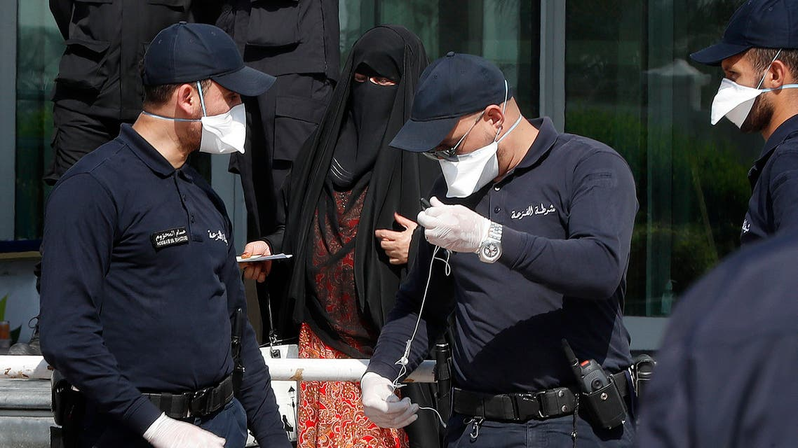 Qatari police stand outside a hotel in Doha where people have been quarantining over fears of coronavirus, on March 12, 2020. (AFP)