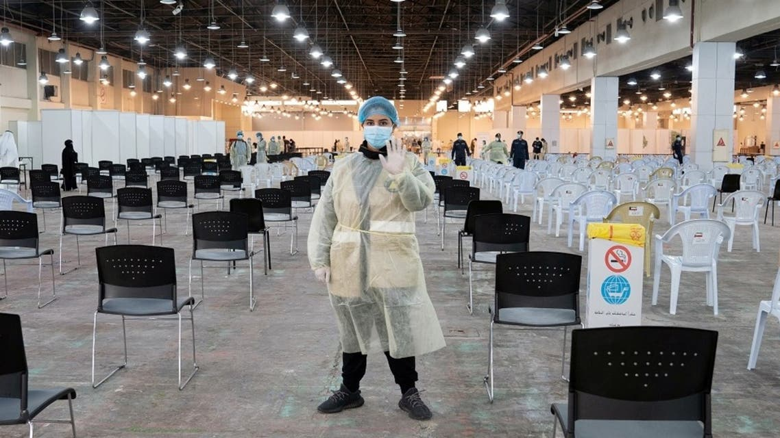 A volunteer, that directs visitors at a coronavirus testing centre, gestures at the Kuwait International Fairgrounds in Mishref, Kuwait March 18, 2020. (Reuters)
