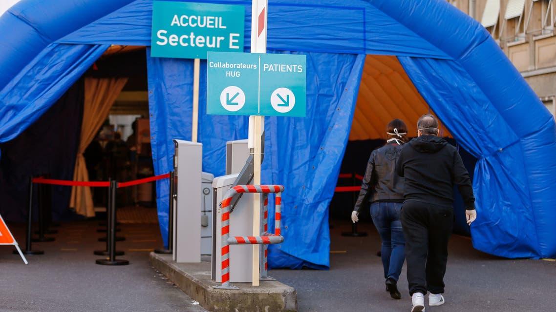 A medical screening tent for coronavirus testing is seen outside the University Hospital of Geneva (HUG), in Geneva, Switzerland March 17, 2020. REUTERS/Pierre Albouy