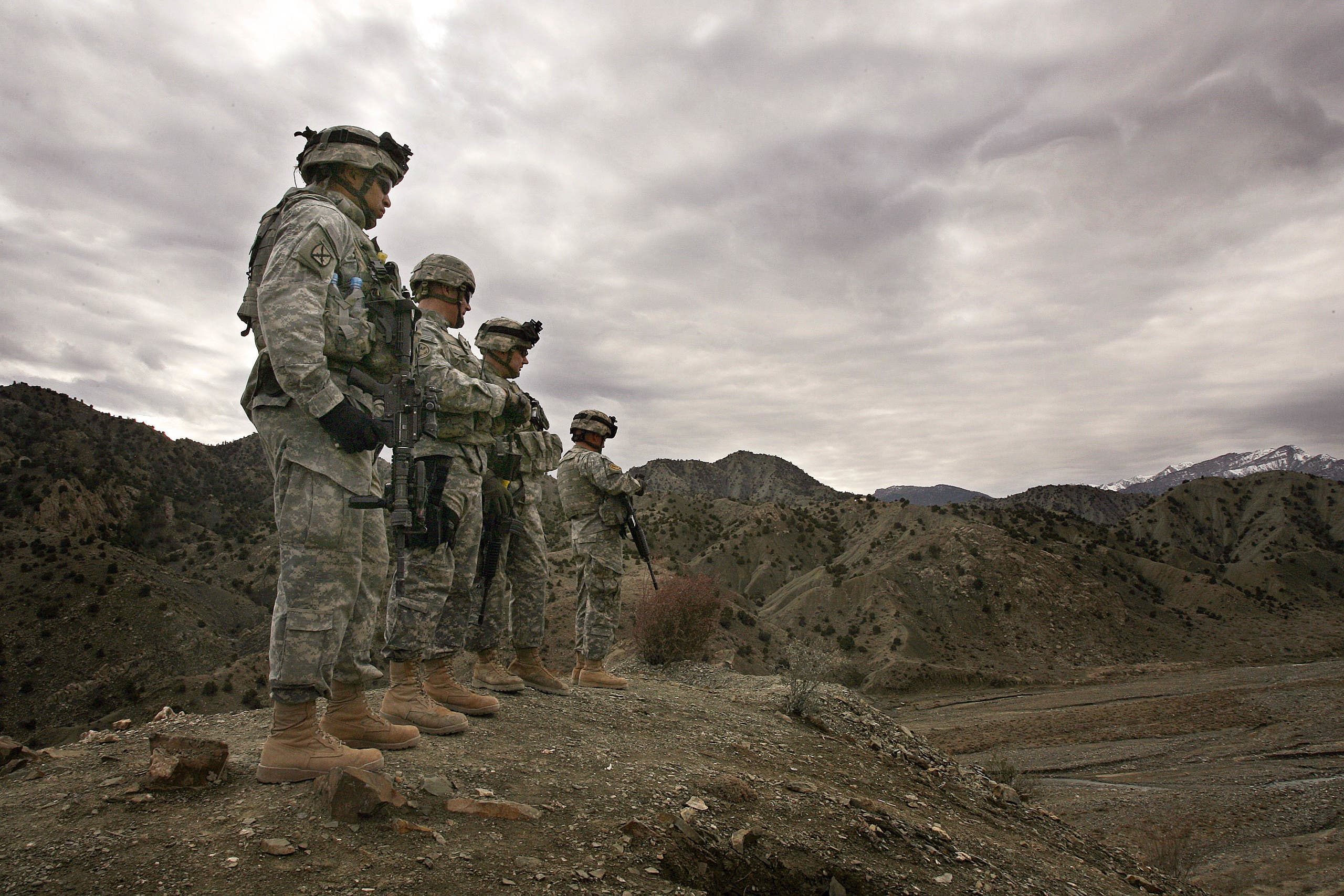 In this file photo, US soldiers  look out over the landscape around Firebase Wilderness in Gardez province in Afghanistan.