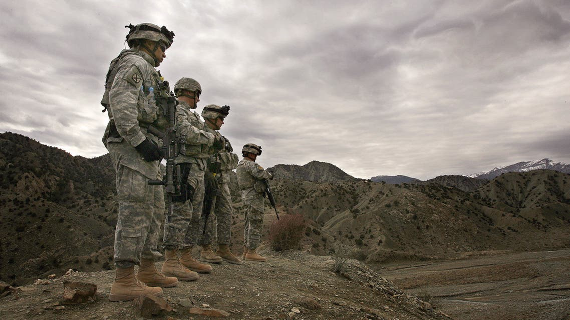 (FILES) In this file photo taken on November 20, 2006, US soldiers from 3rd Brigade Special Troops Battalion, 10th Mountain Division, look out over the landscape around Firebase Wilderness in Gardez province. American forces have started pulling out of two bases in Afghanistan, a US official said on March 10, 2020 the day peace talks between Kabul and the Taliban were due to start despite widespread violence and a political crisis. The United States is keen to end its longest-ever conflict, and under the terms of a deal signed in Doha last month has said all foreign forces will quit Afghanistan within 14 months -- provided the Taliban stick to their security commitments.