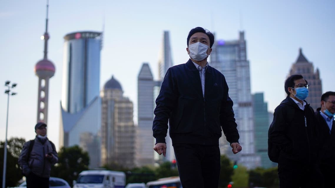 People wear protective face masks, following an outbreak of the novel coronavirus disease (COVID-19), at Lujiazui financial district in Shanghai, China, March 19, 2020. (Reuters)