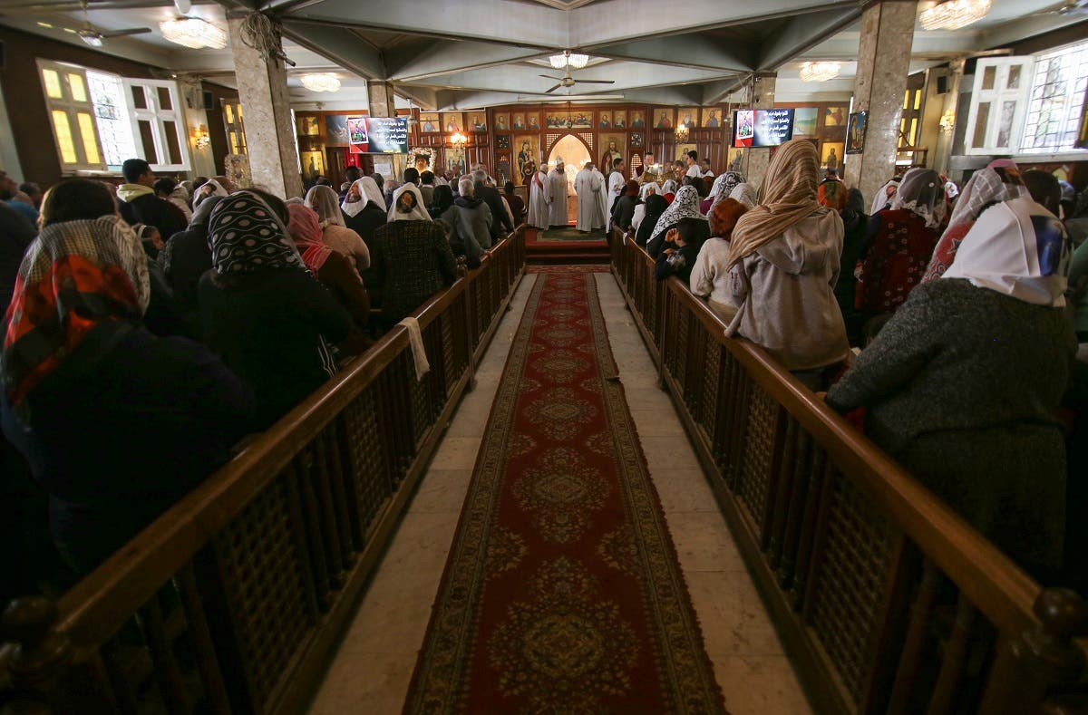 Christian Copts attend Sunday mass and listen to the priest at the Archangel Michael Church after government instructions on preventing the spread of coronavirus, in Cairo, Egypt March 15, 2020. (Reuters)