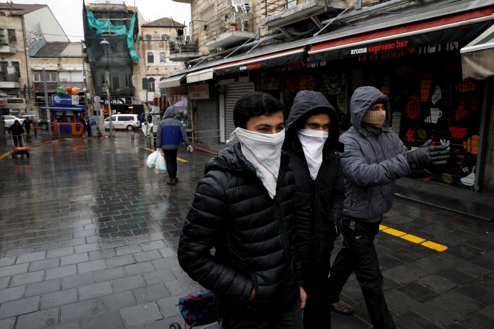 People walk in the main market in Jerusalem while Israel tightened a national stay-at-home policy following the spread of coronavirus disease in Jerusalem March 20, 2020. (Reuters)