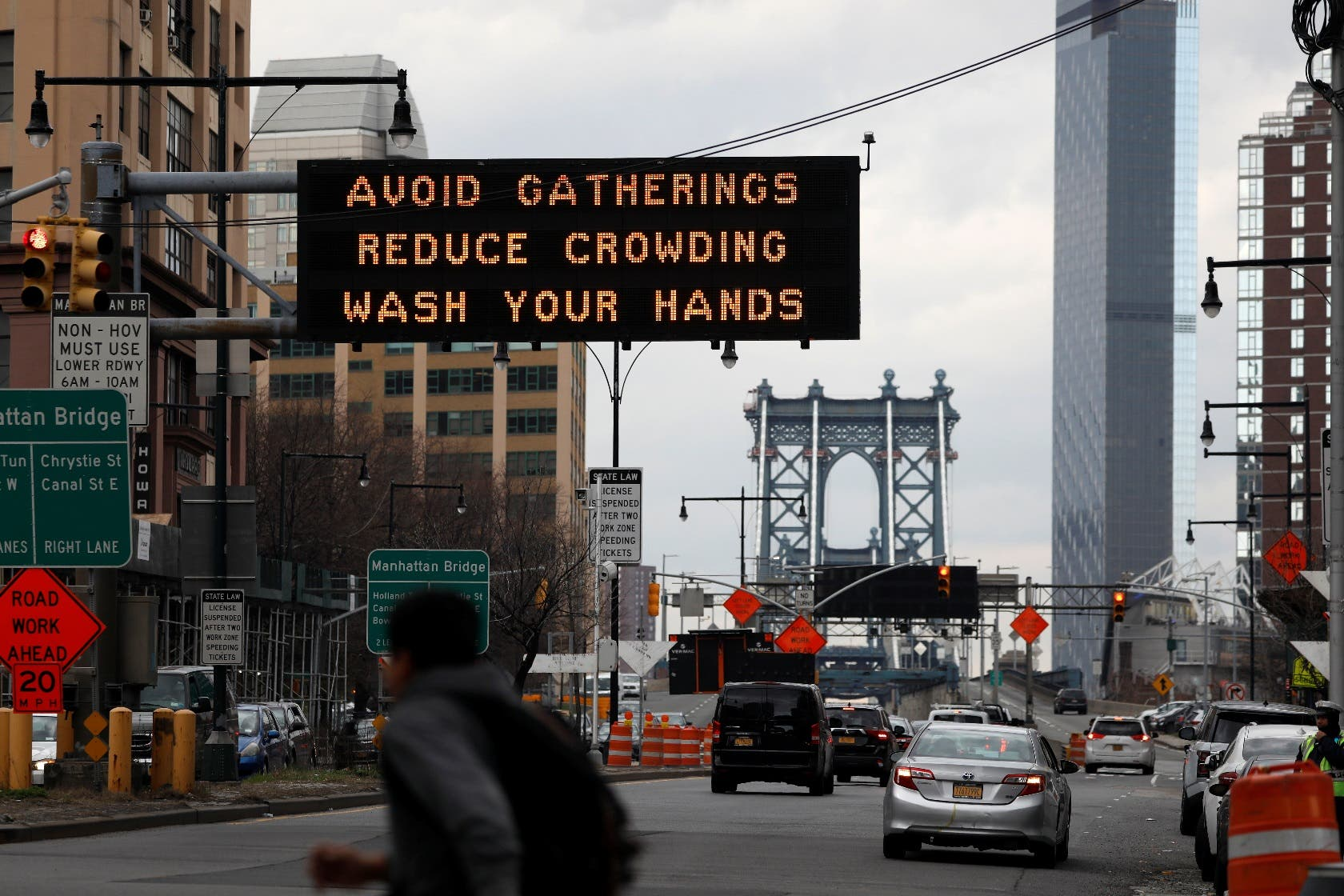 Signage regarding the coronavirus disease is displayed at the entrance to the Manhattan Bridge in the Brooklyn borough of New York City, on March 20, 2020. (Reuters)
