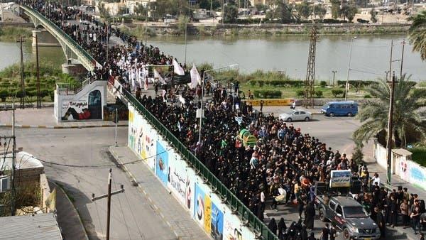 العراقيون يتحدون فرض التجول.. وعشرات الآلاف يجتمعون