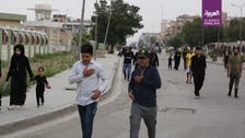 Thousands of Iraqi Shias defy coronavirus curfews to commemorate imam