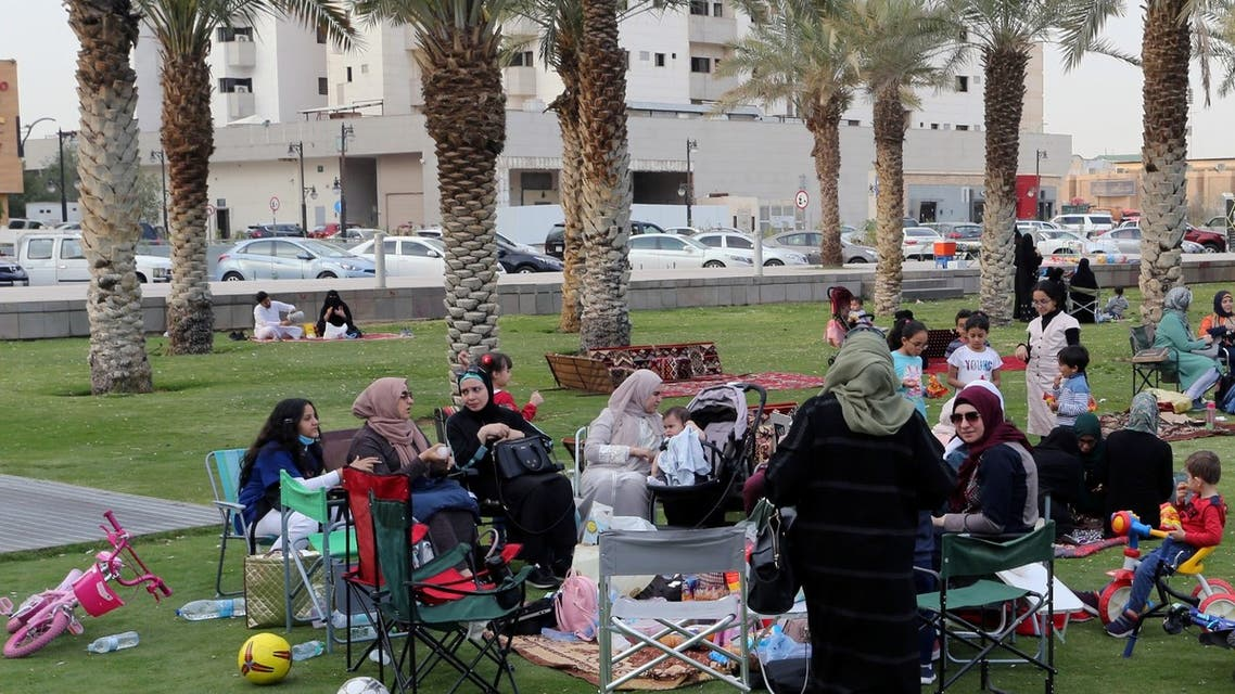 Visitors sit in the garden of the King Fahd Library, following an outbreak of coronavirus, in Riyadh, Saudi Arabia, March 12, 2020. (Reuters)