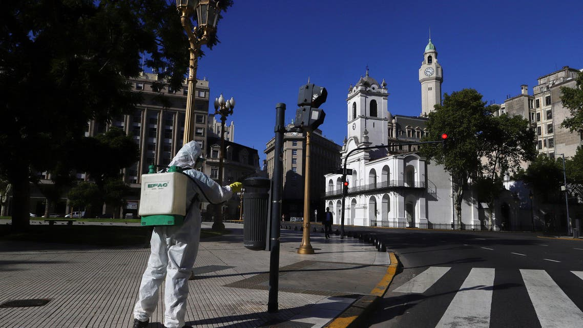 A worker disinfects Plaza de Mayo after Argentina's President Alberto Fernandez announced a mandatory quarantine as a measure to curb the spread of coronavirus disease (COVID-19), in Buenos Aires, Argentina March 20, 2020. (Reuters)