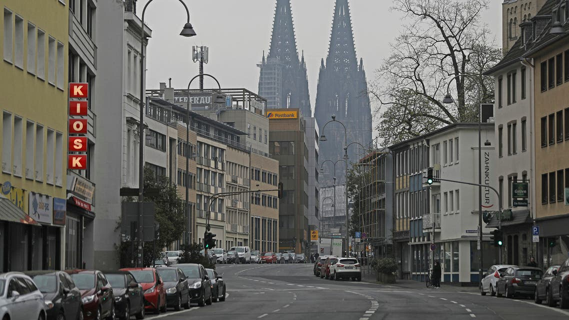 Gereonstrasse is deserted in front of the Cologne Cathedral in Cologne, Germany, Friday, March 20, 2020. (AP)