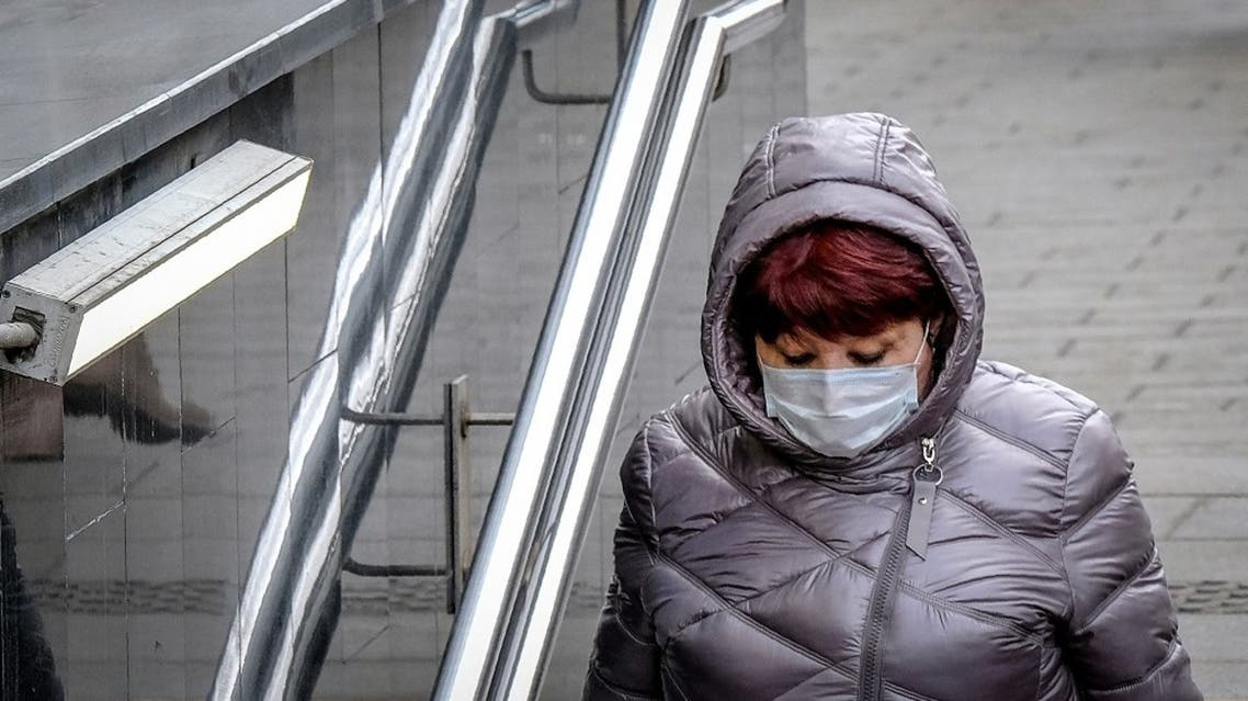 A woman wearing a face mask, amid concerns of the COVID-19 coronavirus, walks in Moscow on March 23, 2020. (AFP)