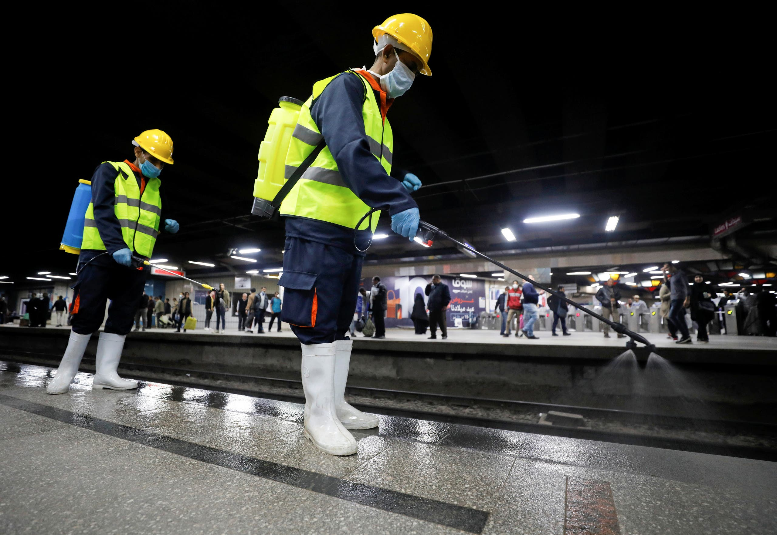A member of medical team sprays disinfectant as a precautionary move amid concerns over the coronavirus disease (COVID-19) outbreak at the underground Al Shohadaa Martyrs metro station in Cairo, Egypt on March 22, 2020. (Reuters)