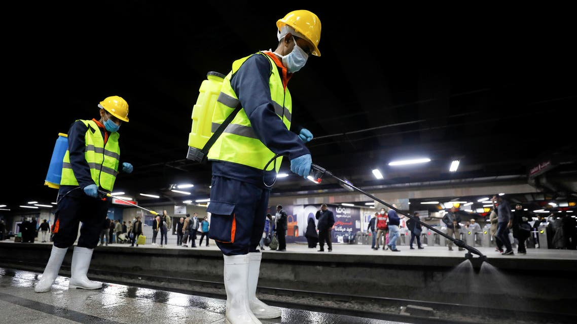 A member of medical team sprays disinfectant as a precautionary move amid concerns over the coronavirus disease (COVID-19) outbreak at the underground Al Shohadaa Martyrs metro station in Cairo, Egypt March 22, 2020. REUTERS/Mohamed Abd El Ghany