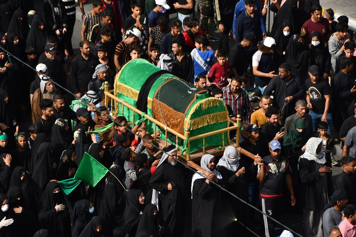 Iraqi Shiite pilgrims carry a mock coffin on their shoulders to mark the anniversary of the death of Imam Moussa al-Kadhim, as they defy a curfew imposed by the authorities to prevent the spread of novel coronavirus COVID-19. (Reuters)