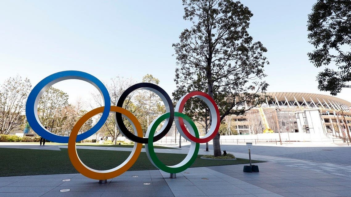 Olympic rings monument in front of National Stadium. (Reuters)