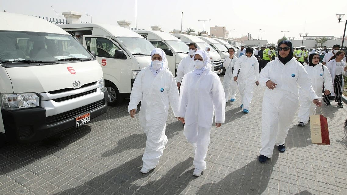A team of doctors and nurses prepare themselves before heading out to their designated residential areas to check on residents who returned from Iran if anyone is infected with the novel coronaviru. (File photo: Reuters)