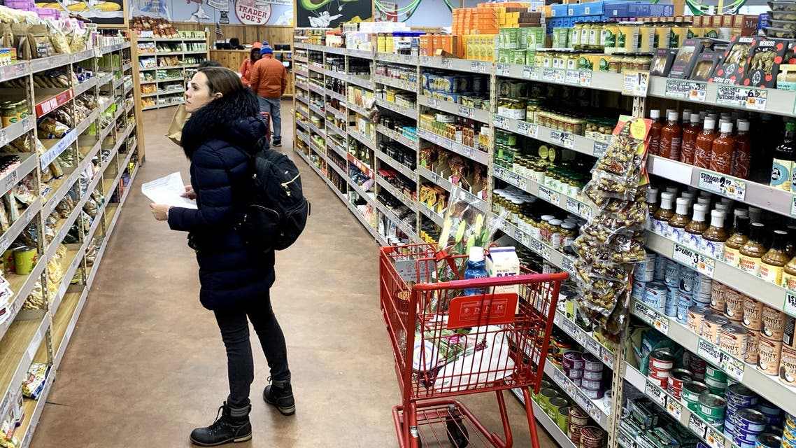A woman shops at Trader Joe's at on March 23, 2020 in Cambridge, Massachusetts. (AFP)