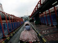 تخفيف القيود على معقل كورونا بالصين وتفشٍّ بإندونيسيا وماليزيا