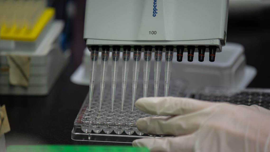 This photo taken on March 11, 2020 shows a lab techician working on a neutralising antibody test on the Middle Eastern Respiratory Syndrome (MERS) coronavirus at a Bio Safety Level (BSL) 3 laboratory at the International Vaccine Institute (IVI) in Seoul. (AFP)