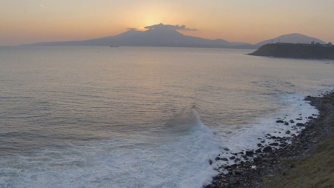 Volcano Mendeleyev is silhouetted against the sunset on Kunashiri Island, one of the Kuril Islands, Russia. (AP)