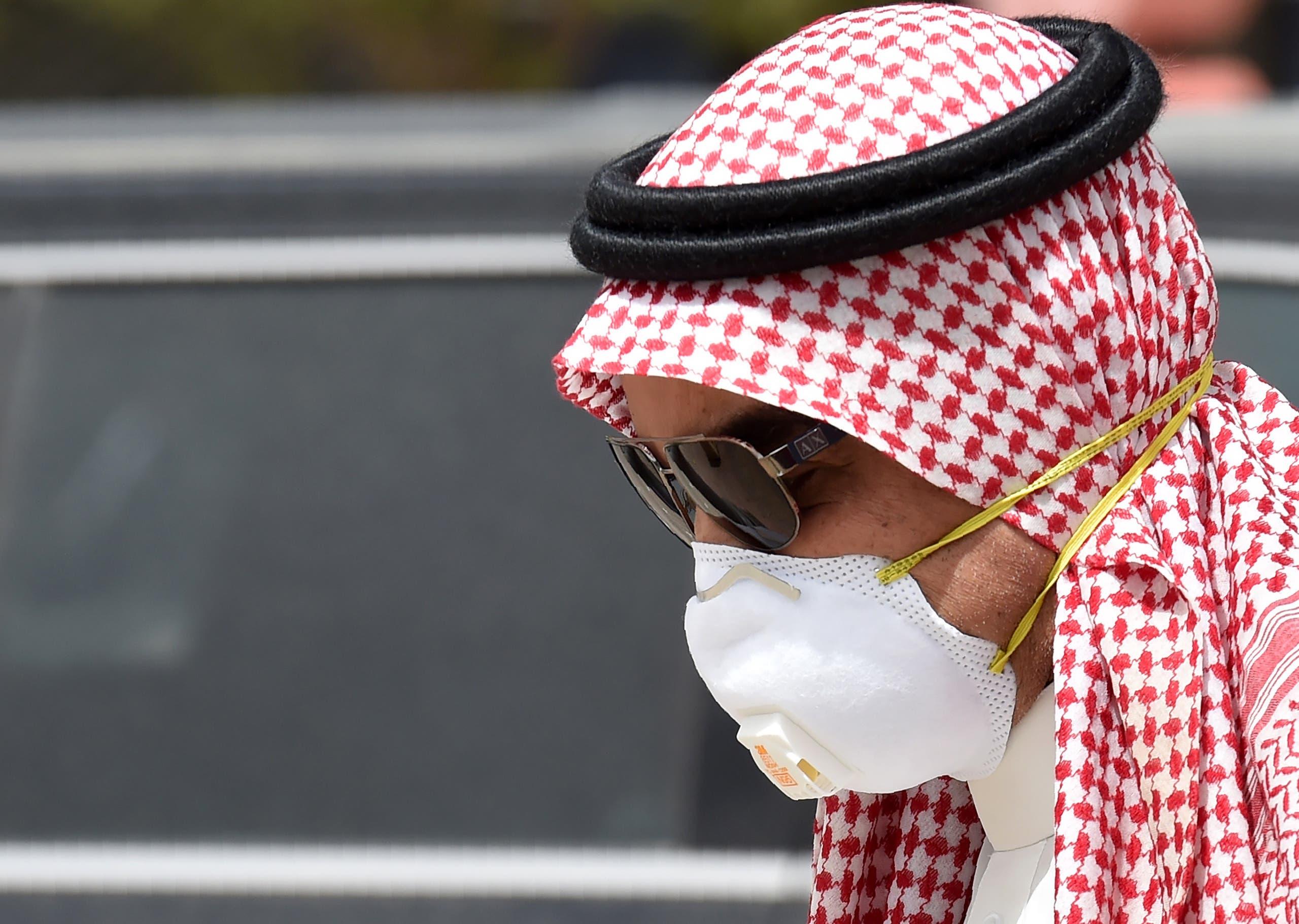 A Saudi man wearing a protective mask as a precaution against COVID-19 coronavirus disease in Riyadh on March 15, 2020. (AFP)