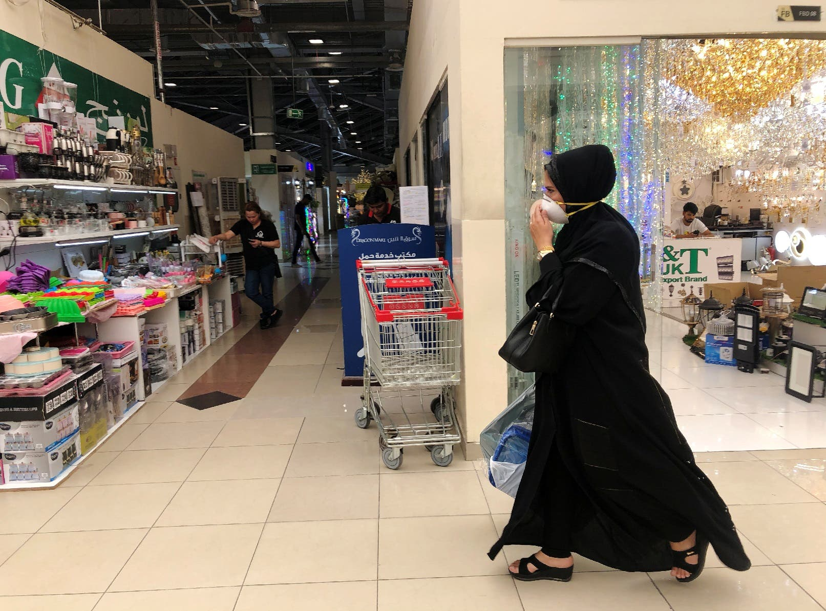 A woman wears a protective face mask, following the outbreak of the new coronavirus, as she walks at Dragon Mart, a Chinese themed discount shopping centre, in Dubai, United Arab Emirates, March 2, 2020. (Reuters)