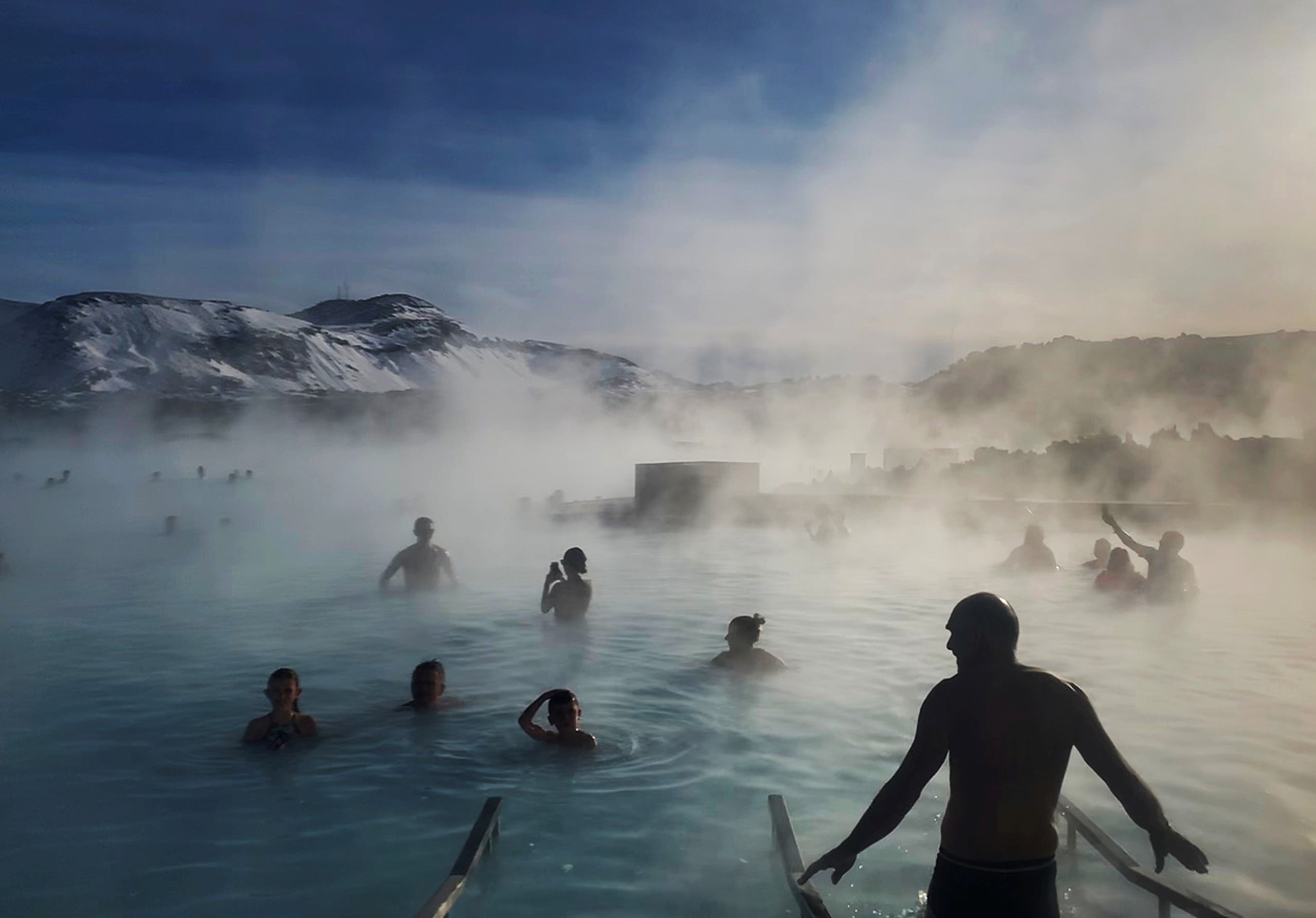 Bathers enjoy the warm volcanic hot springs of the Blue Lagoon in Grindavik, Iceland, March 6, 2020. (Reuters)