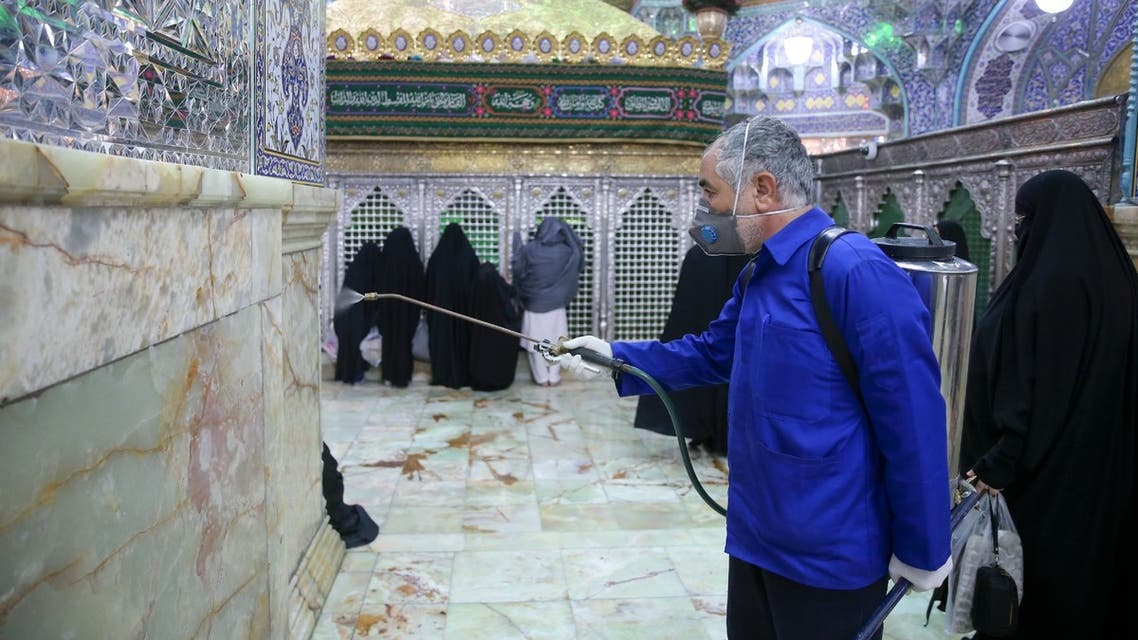 An Iranian sanitary worker disinfects Qom's Masumeh shrine on February 25, 2020 to prevent the spread of the coronavirus which reached Iran, where there were concerns the situation might be worse than officially acknowledged.